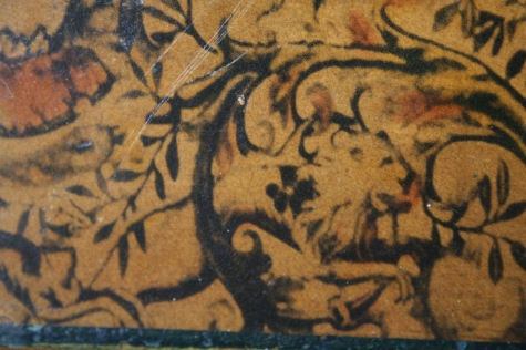 Very hard to see, and this is really small on the table, but does this lion have wings?  Is that a goat behind it?