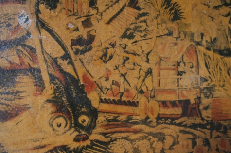 There is a close-up of the attack on the serpent.  Do you see the couple sitting in the front of the boat?
